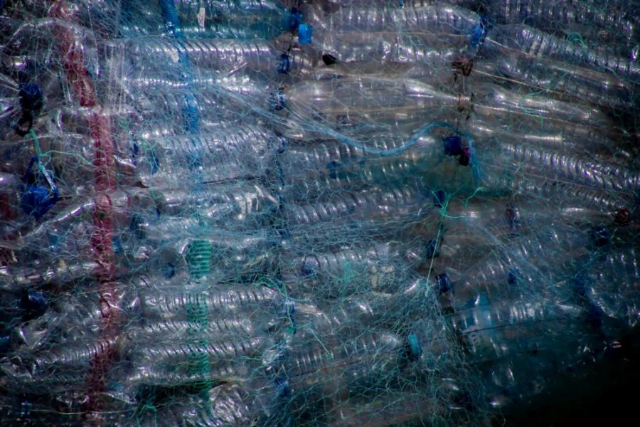 Dozens of plastic water bottles tied together
