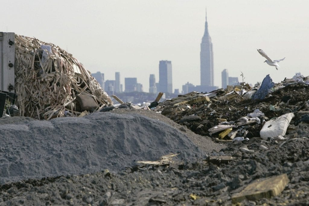 Landfill with city in distance