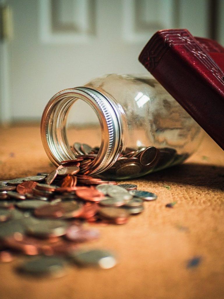 Jar spilling coins