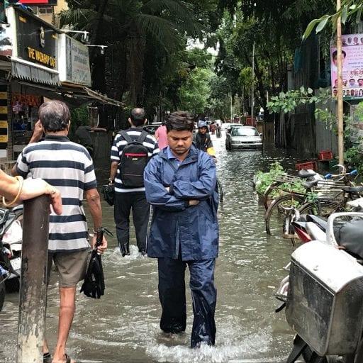 Man walking along flooded street