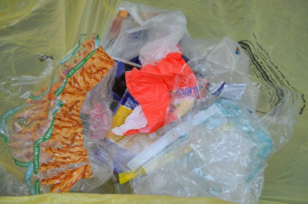 plastic snack packaging in a waste bag