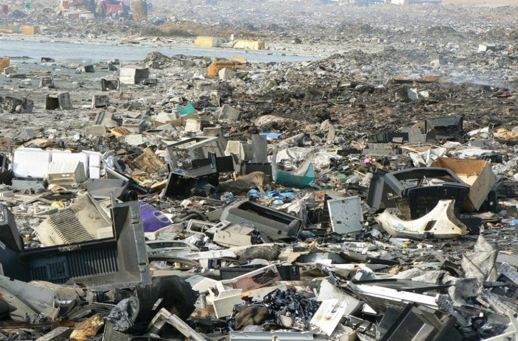 Old TV screens, computers and other objects create a sea of e waste