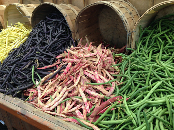 Different colour long beans at a farmers market