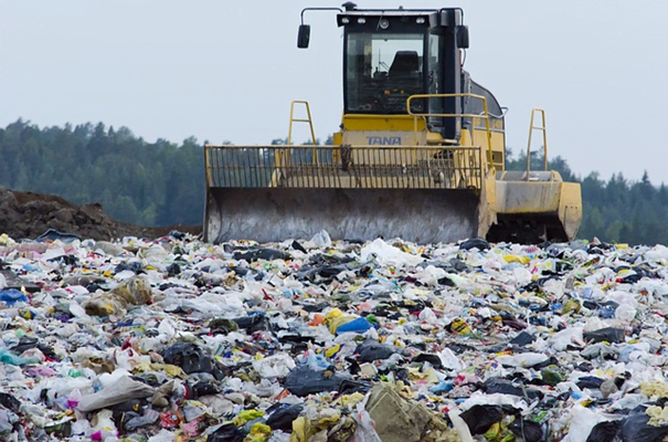 A garbage plow moving through a sea of waste