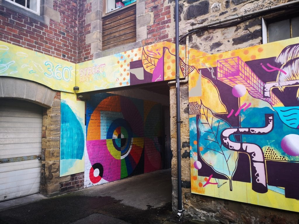Art on the walls in a laneway