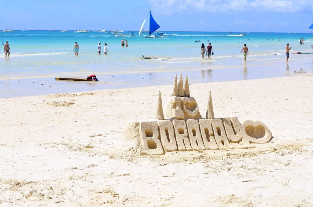 A sandcastle spelling the words I heart Boracay