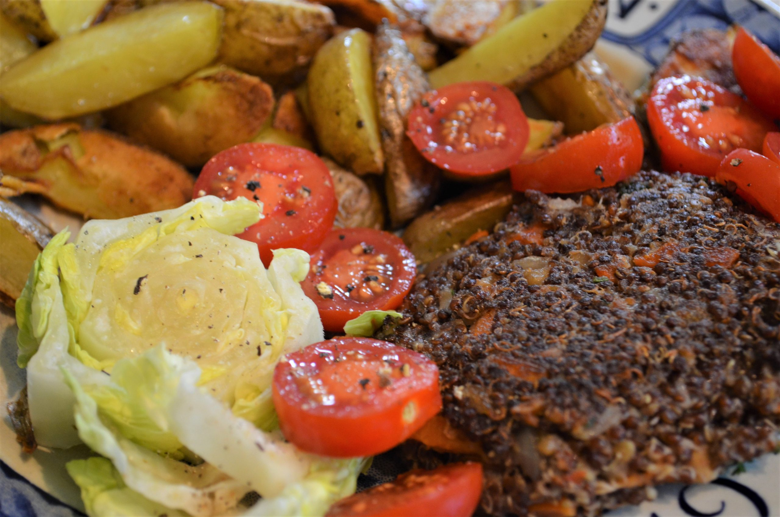Burger patty, chopped tomatoes, cabbage, and green vegetables