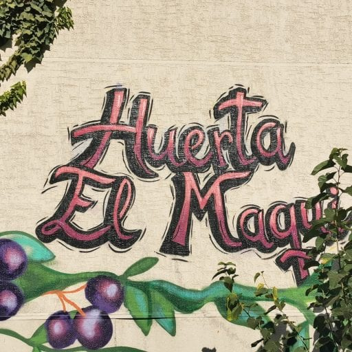 Mural on a wall that reads Huerta El Maqui