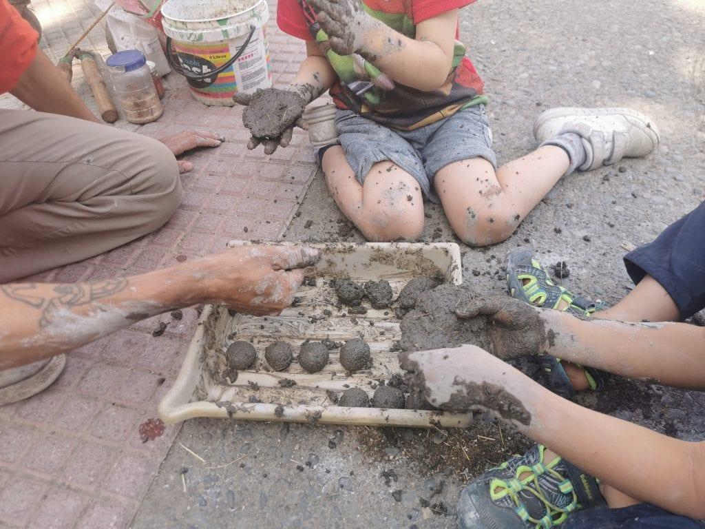 children making seed bombs in community urban gardens