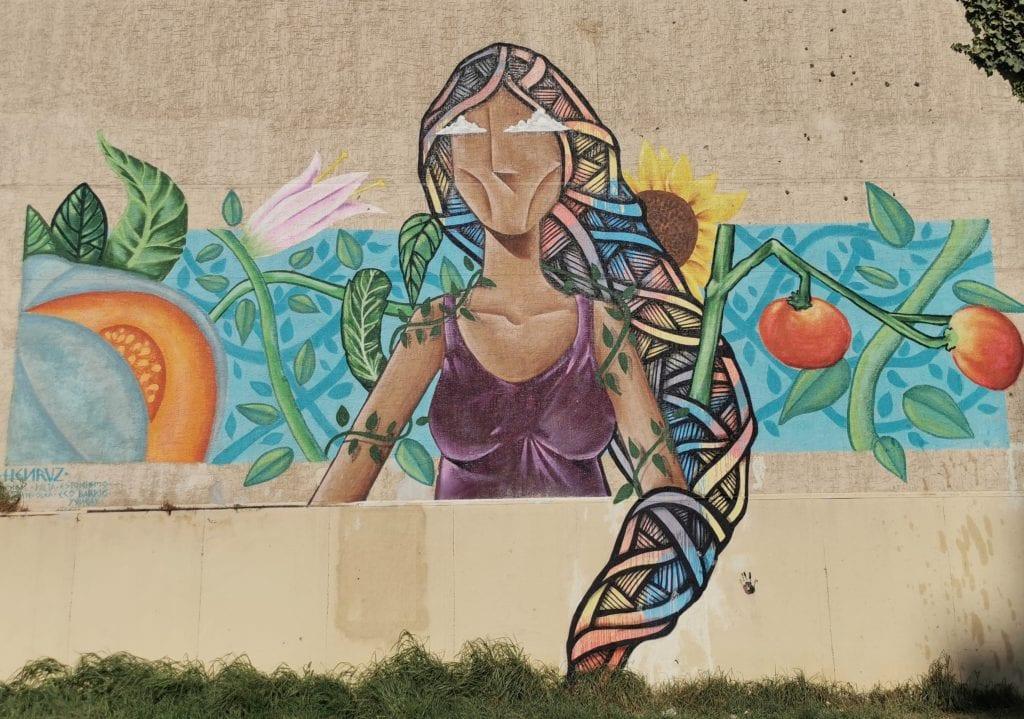Mural of goddess of gardening at Huerta El Maqui
