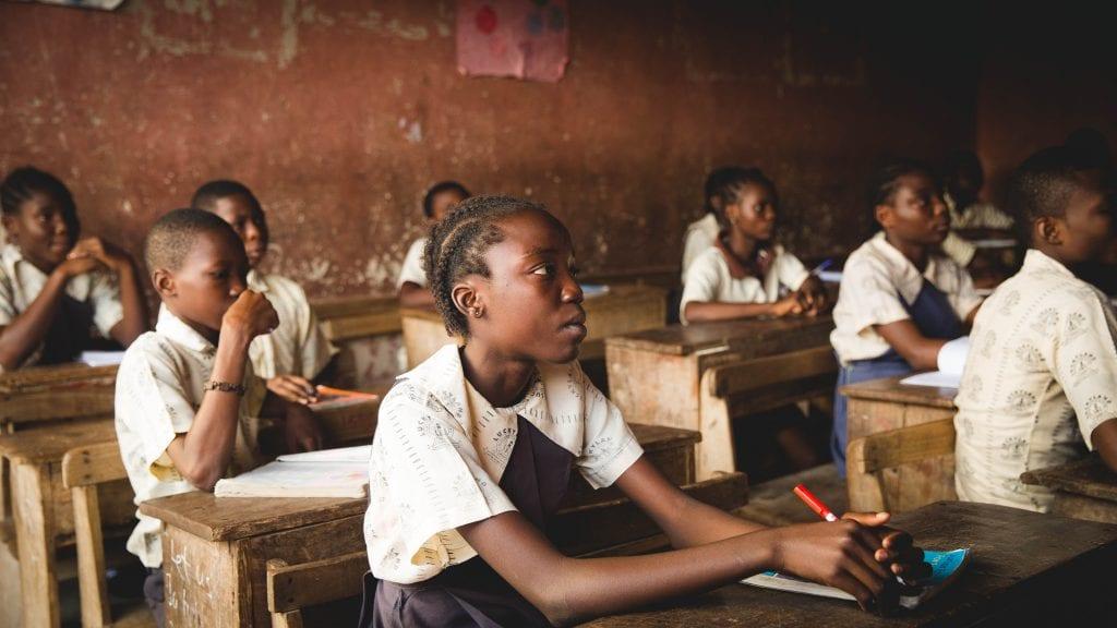 Children sitting at desks inside classrom