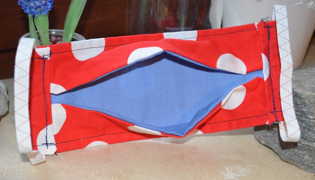 Red face mask with blue interior lining