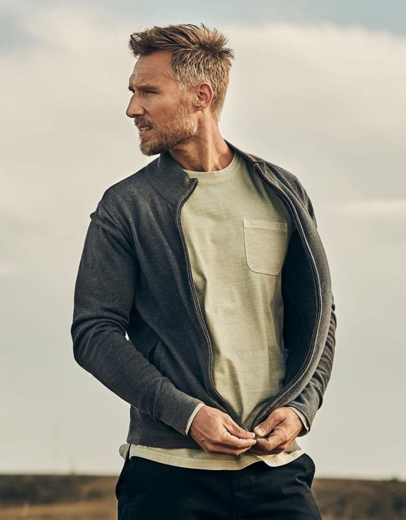 Man wearing jacket, by Pact sustainable activewear