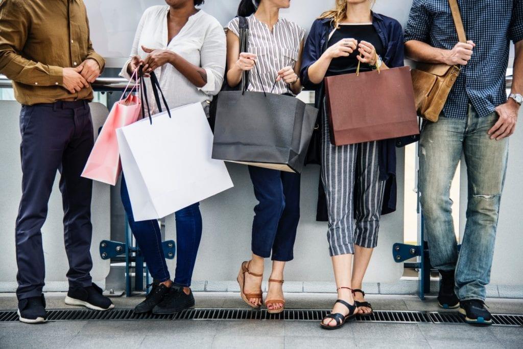 Throwaway fashion: women with shopping bags