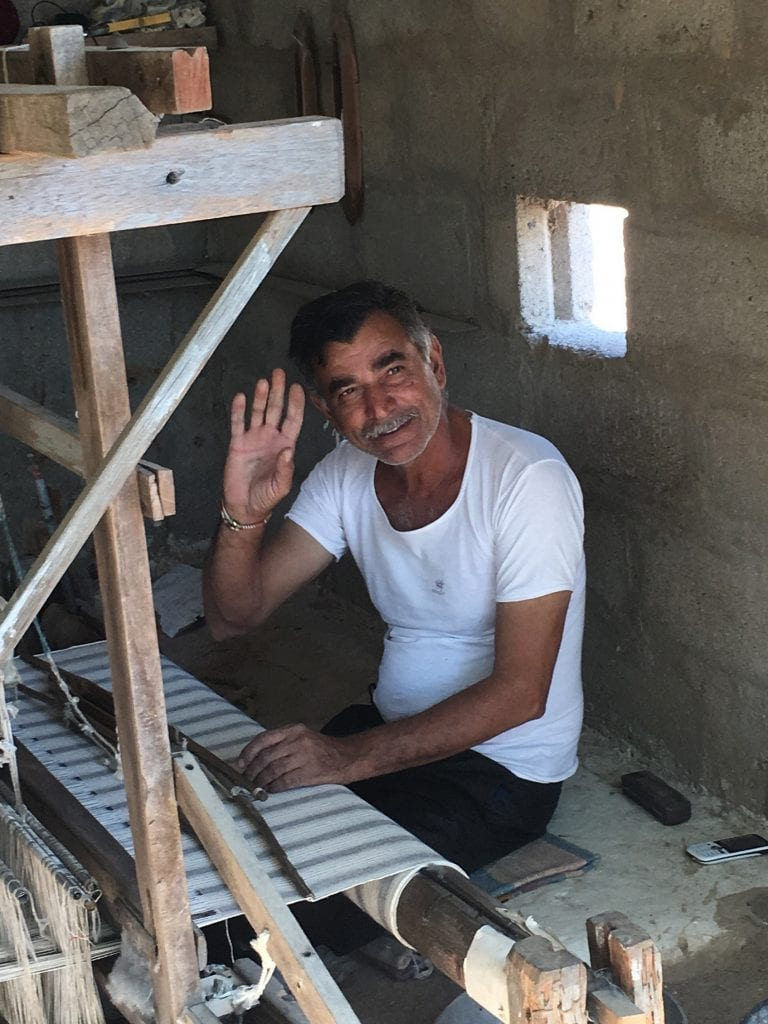 Happy Cotton Weaver waving
