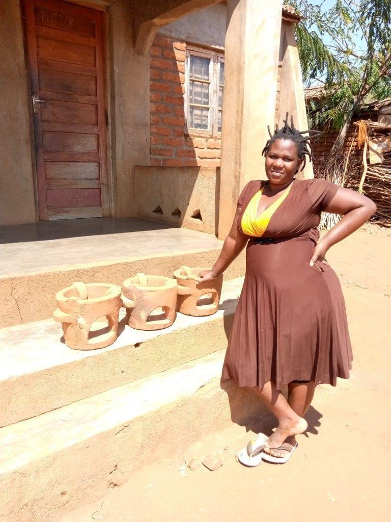Woman standing by Chitetezo Mbaula