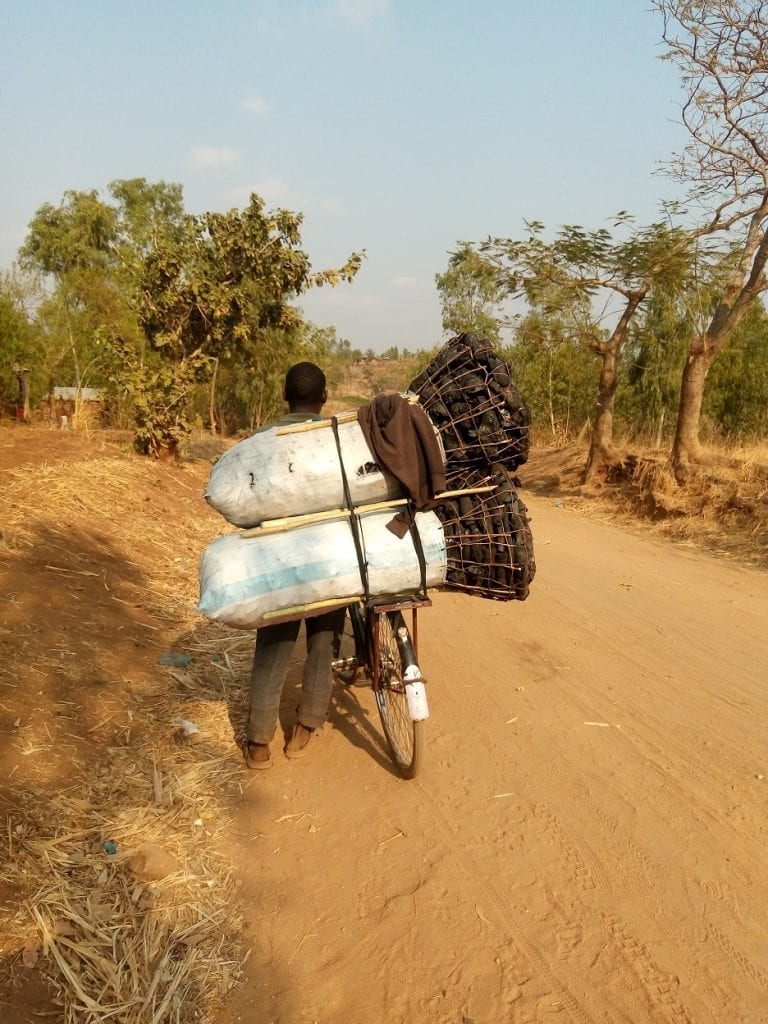 Man on bicycle with heavy load