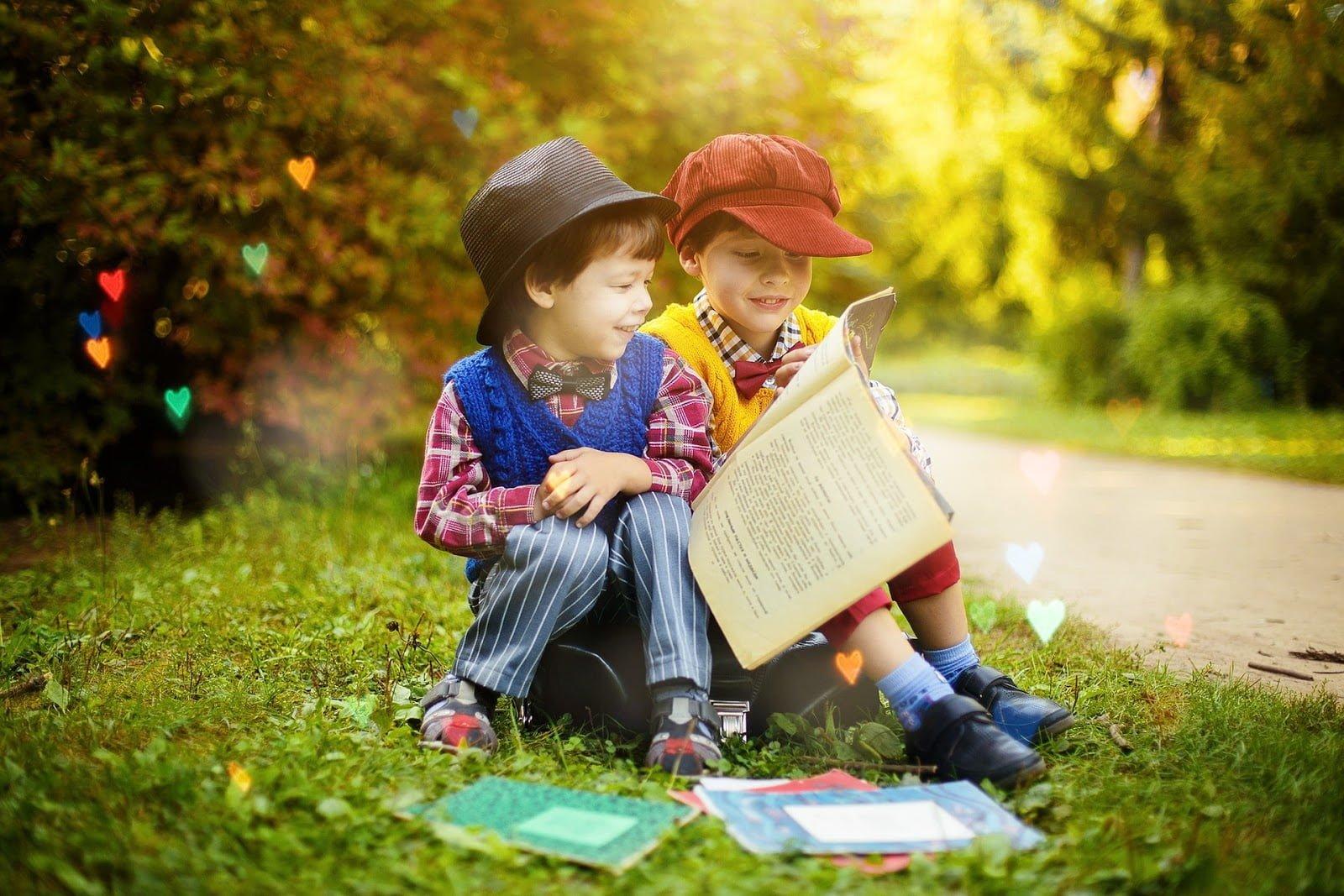 Children reading on grass