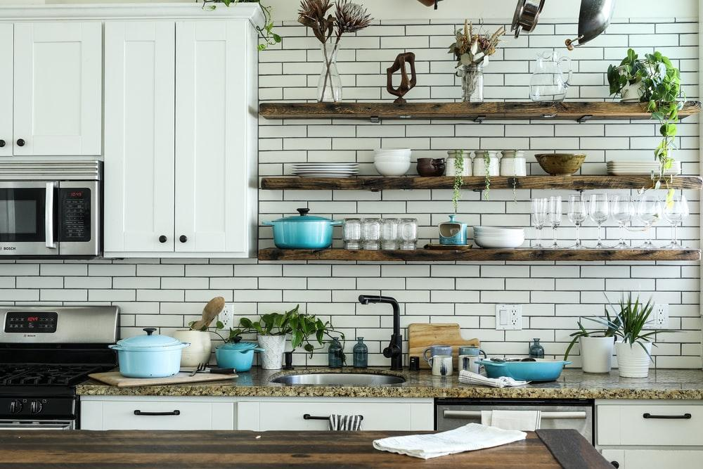 kitchen with marble benchtop and tiled splashback