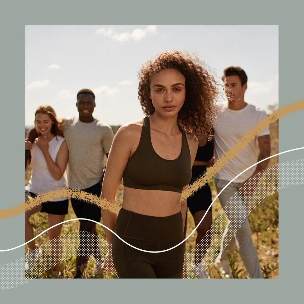 people standing in field, by Boody, a sustainable clothing brand