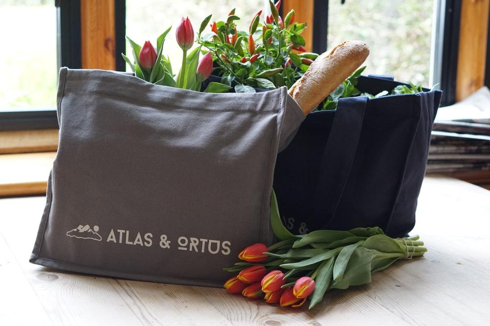 shopping bags with bread and flowers