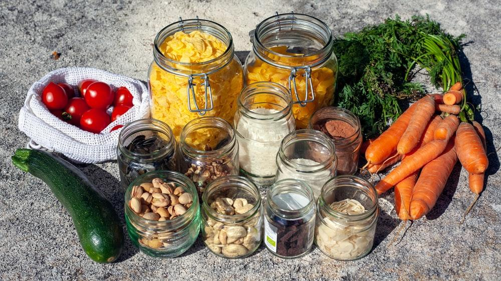 fresh vegetables, and glass jars filled with condiments and spices