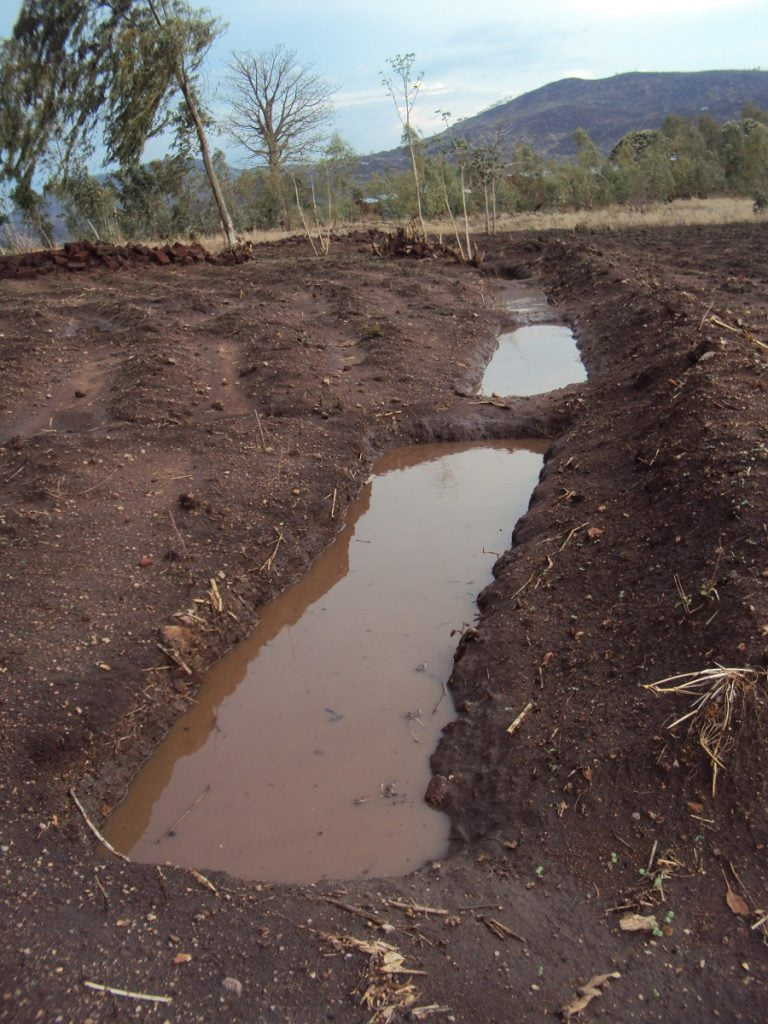 Ground trench filled with water