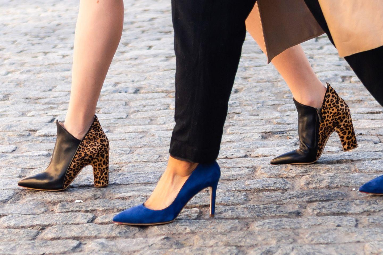 a leopard print shoe and a blue swede shoe