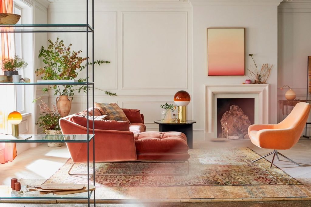 Sustainable furniture & home decor: a cream coloured room with orange furniture, and sunlight streaming in