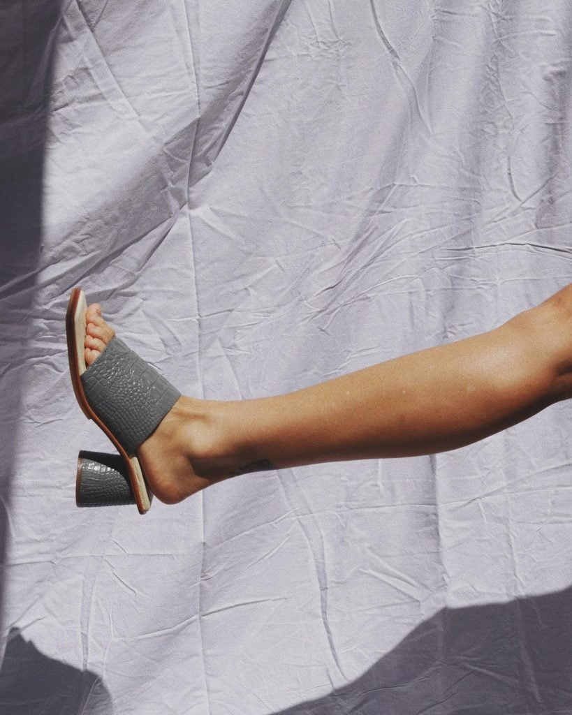 outstretched foot with high-heeled shoe by Batu, a sustainable footwear brand