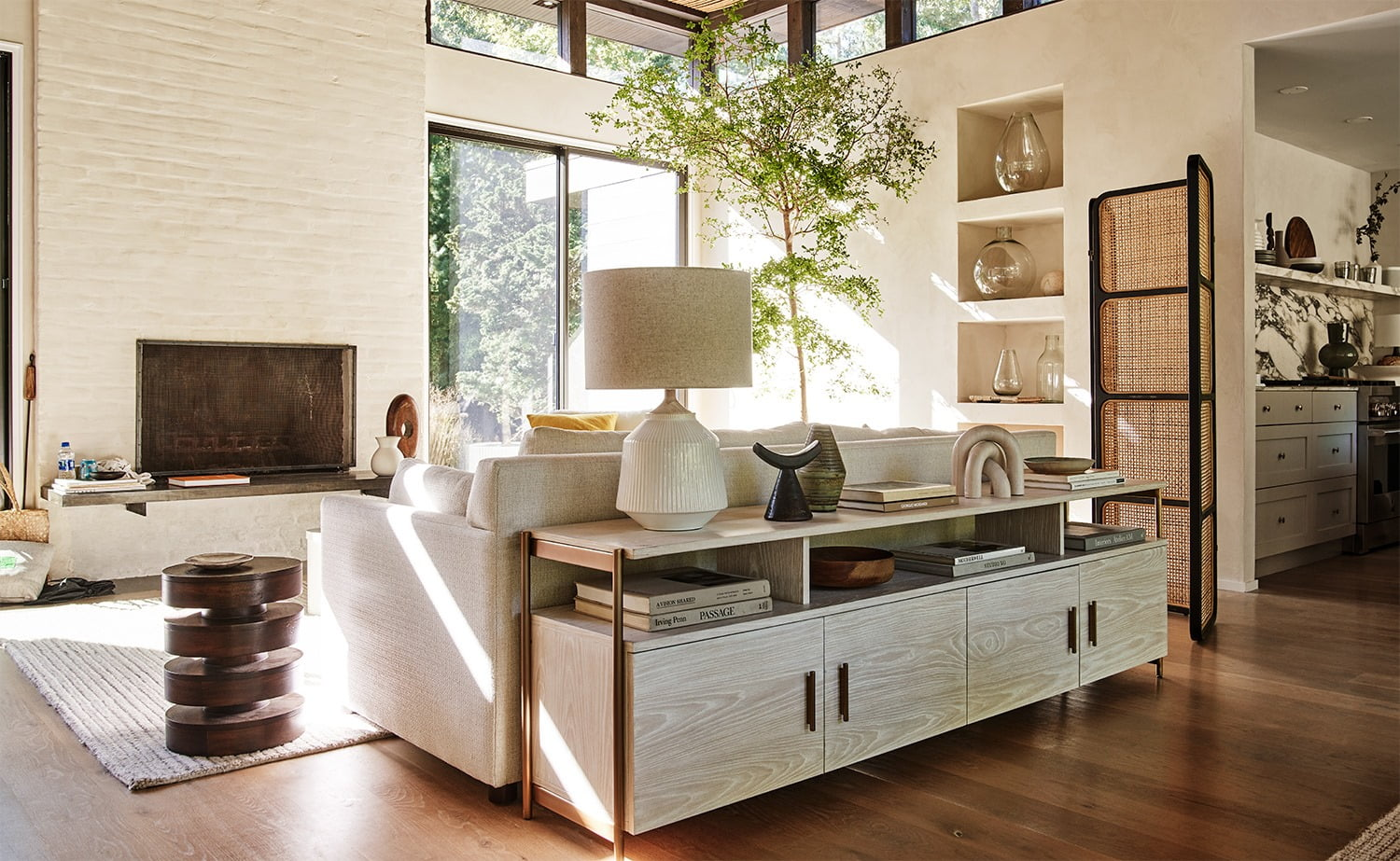 Sustainable furniture & home decor: wooden furniture filling a living room in the daytime