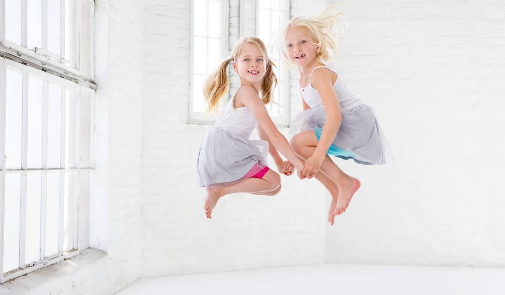 Two children jumping mid-air