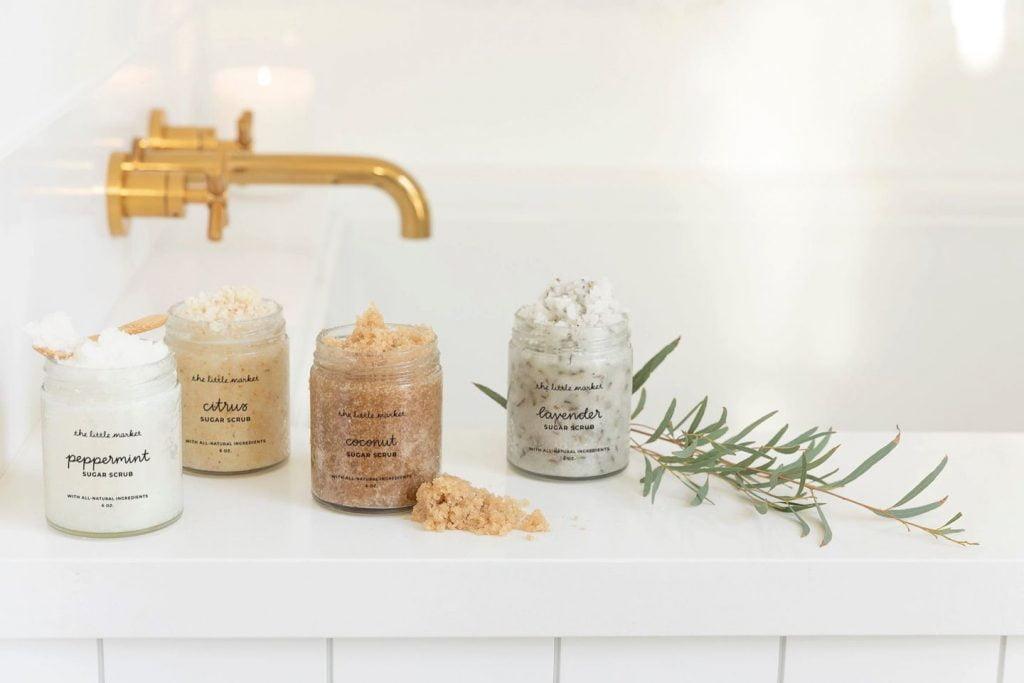 Bath salts in jars, by a brass faucet