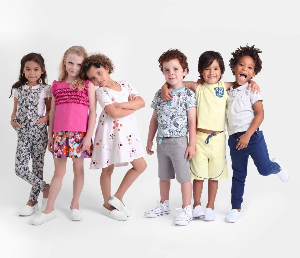 6 kids standing on white background
