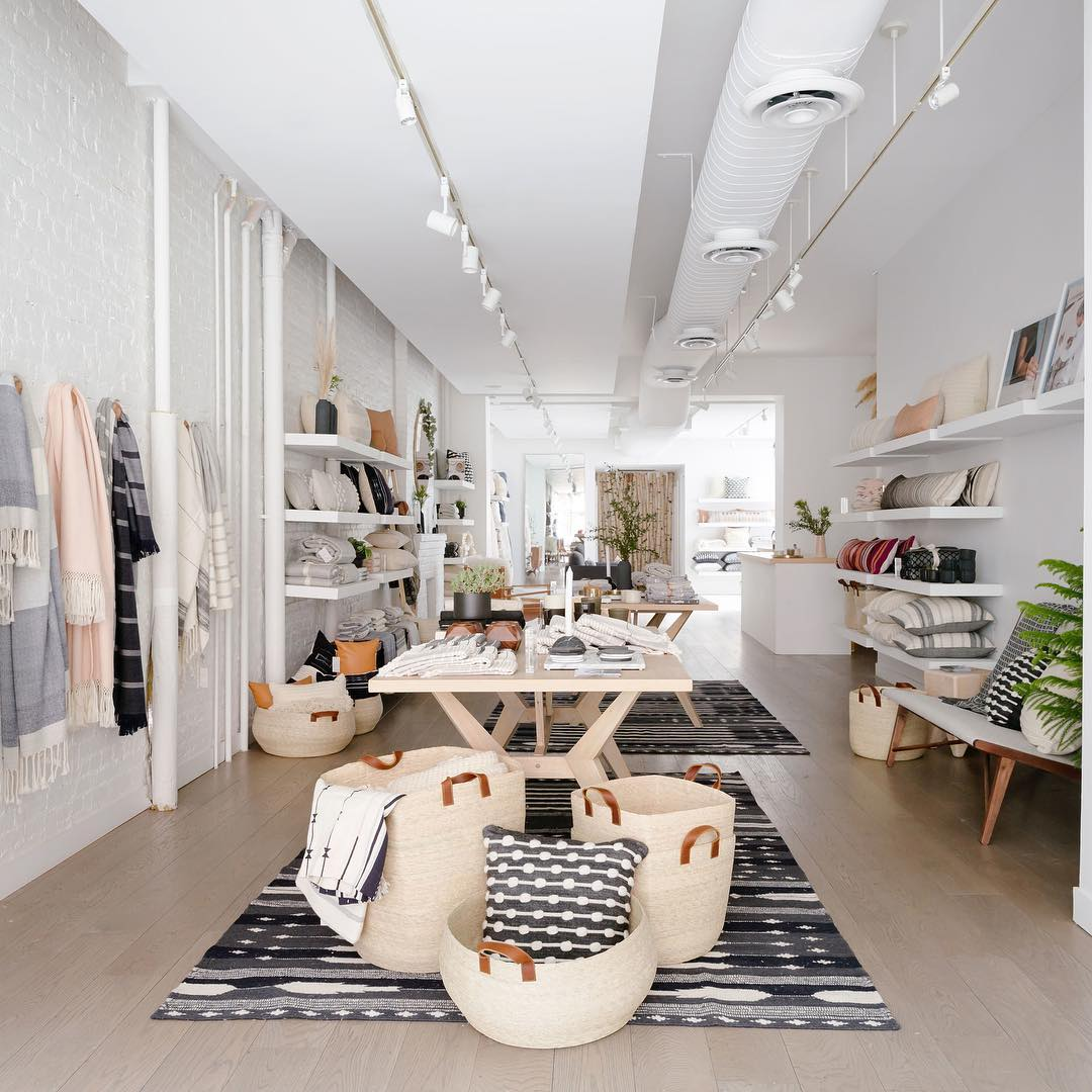 Store with rugs, baskets, chairs, bedding, and other home decor
