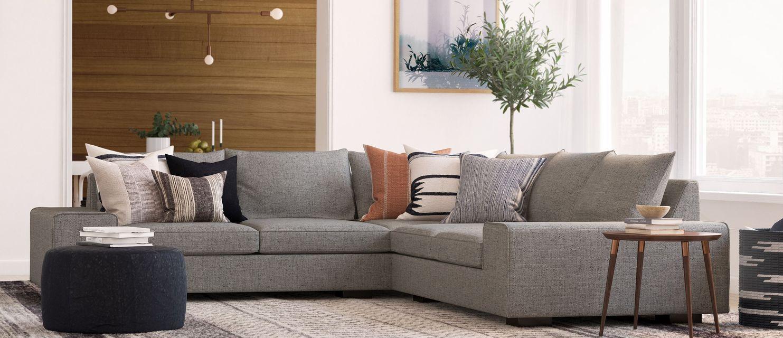 Sustainable furniture & home decor: Comfy-looking sofa under designer lights