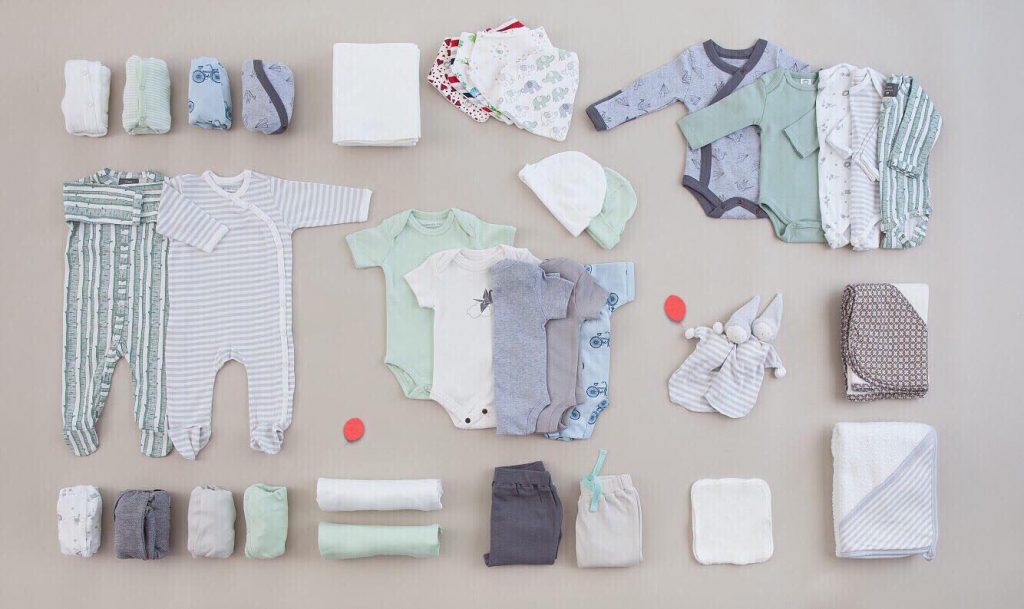 Childrens clothing laid out by UpChoose, a sustainable kids' clothing brand