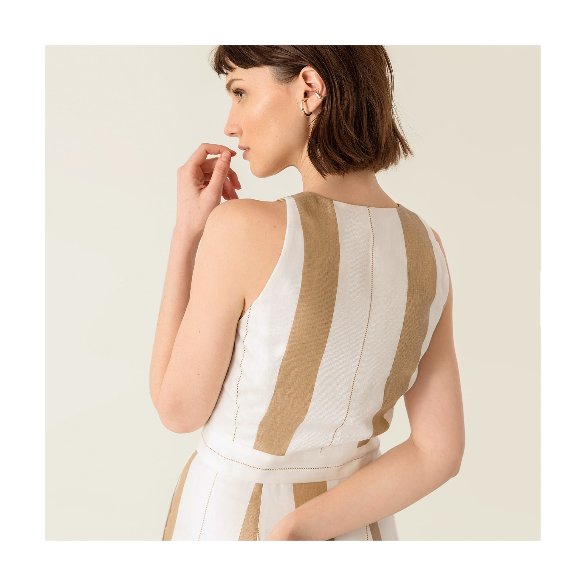 brown and white sleeveless dress by Ivy & Oak, a sustainable clothing brand