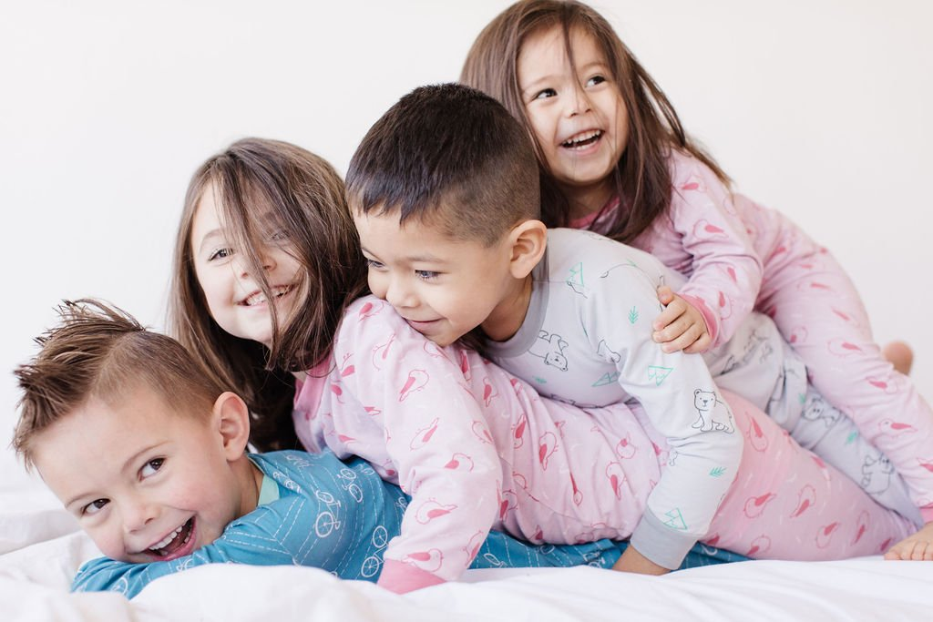 4 kids playing by Lark, a sustainable kids' clothing brand