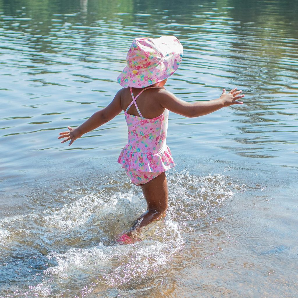 kids wading into water