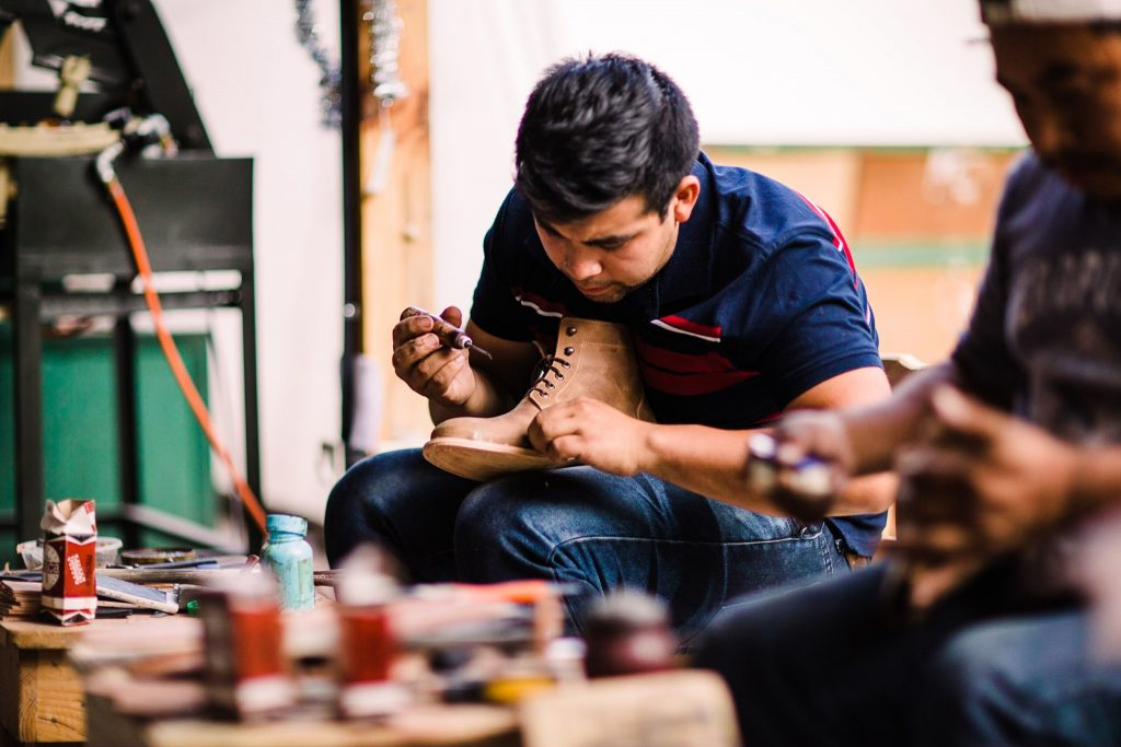 cobbler working on handcrafted shoe
