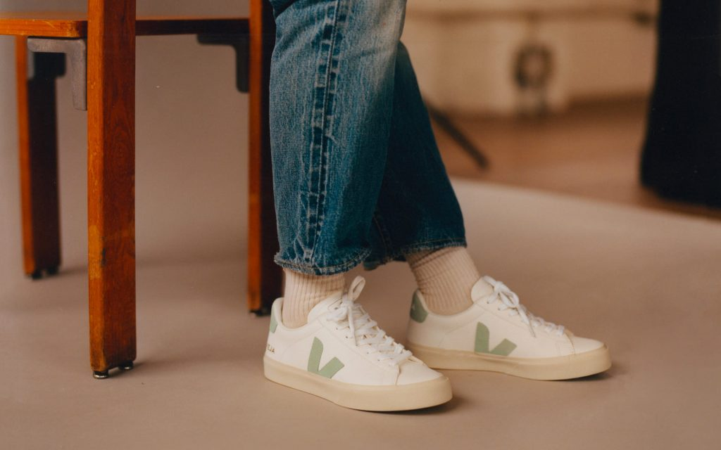 white vegan shoes with a green V