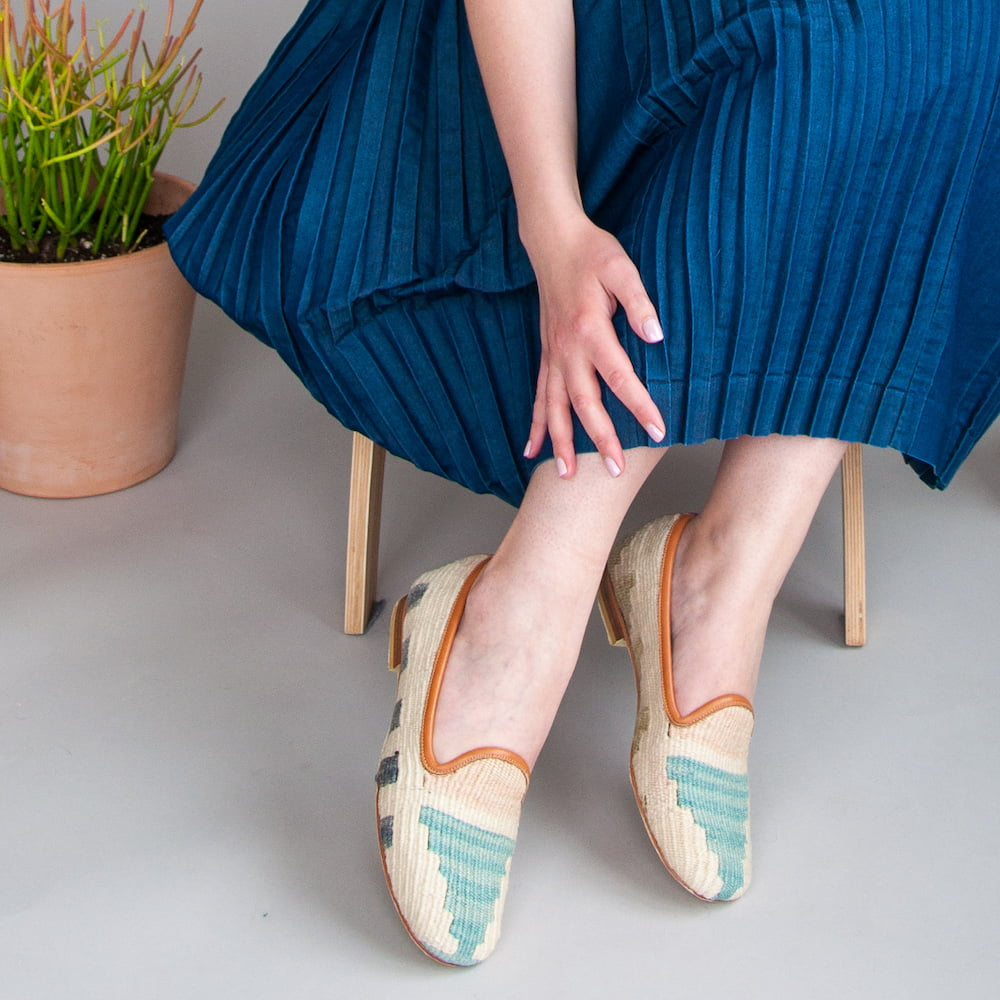 lady in blue skirt and handmade shoes by Ocelot, a sustainable footwear brand
