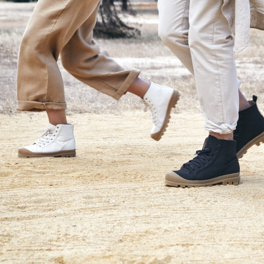 Vegan shoes walking across sand
