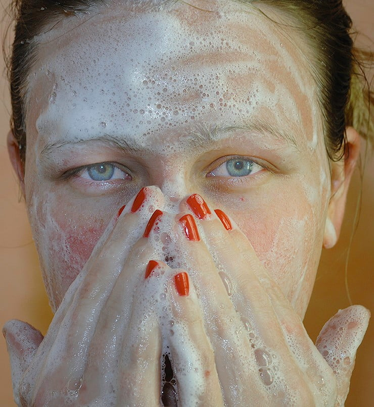 woman's face lathered with soap