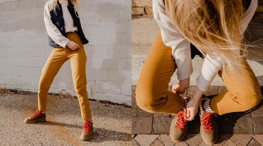 person in street with orange pants, brown shoes, red laces