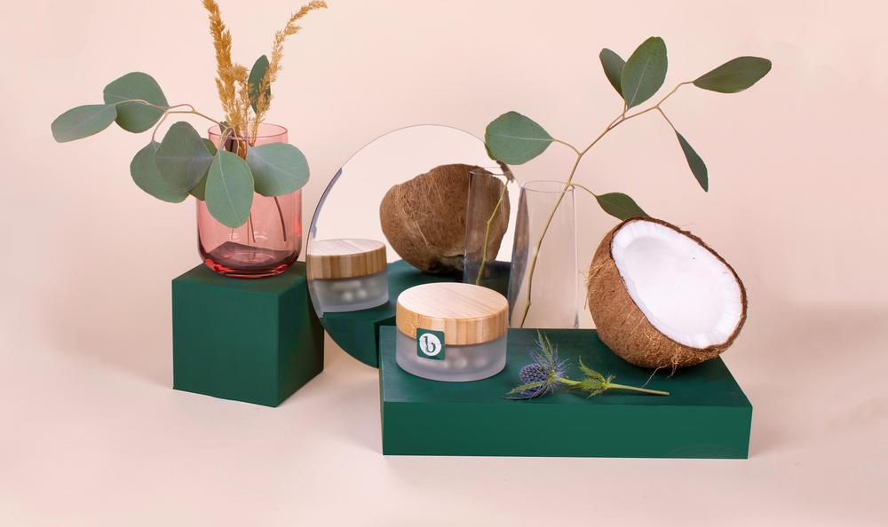 leaves, coconut, and product jar