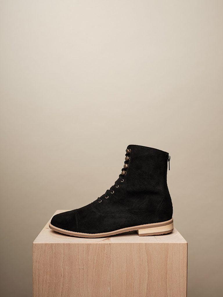 black shoe on wooden block
