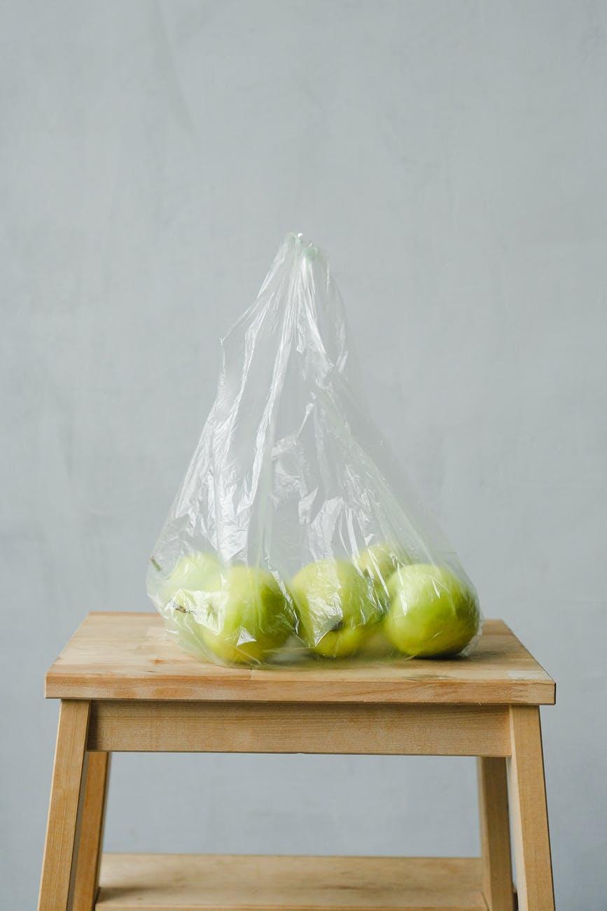 green apples inside a plastic bag
