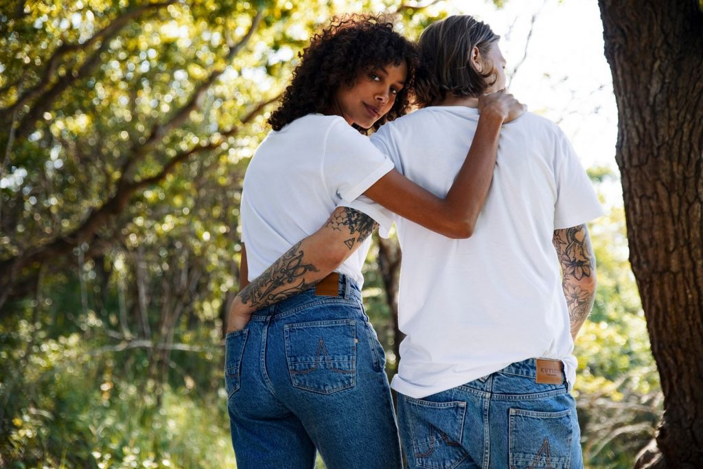 two people in jeans and white t-shirts